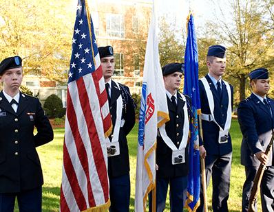 veterans holding american flag