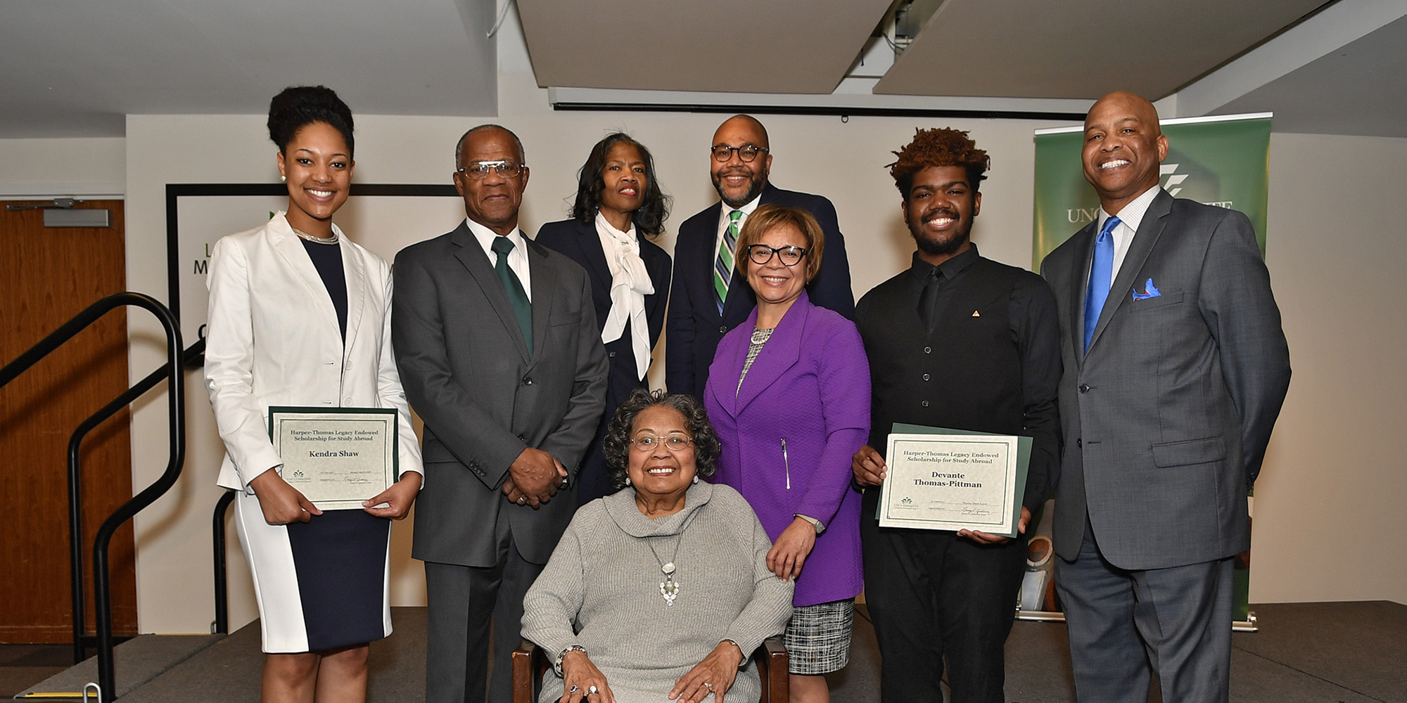 Kendra Shaw, left, and Devante Thomas-Pittman, second right, are the inaugural recipients of the Harper-Thomas Legacy Endowment for Study Abroad. The award honors Mary Harper, seated, and Henry Thomas, second left.